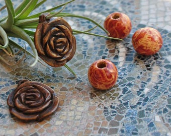 Carved wooden flower charm and beads coconut balls