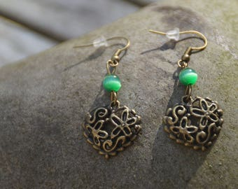 Earrings made with a bronze heart and green