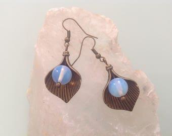Earrings bronze leaf and opal glass bead.