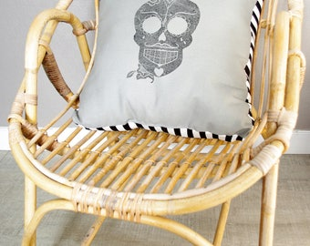 Soft gray and striped cushion pattern skull