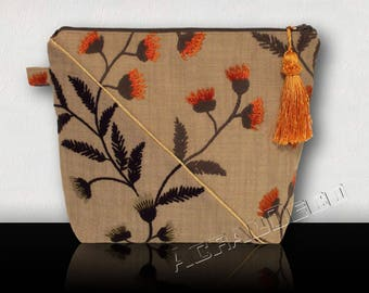 Toiletry woman embroidered flowers and leaves bi - color brown/green/orange. Gold piping on the diagonal. HAND MADE.