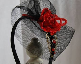 Fascinator on headband in red and black wedding