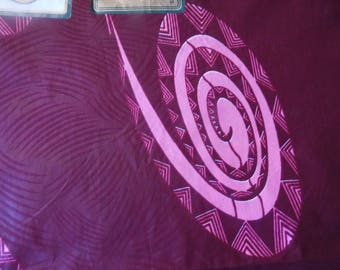 Rose/Burgundy cotton African wax fabric.