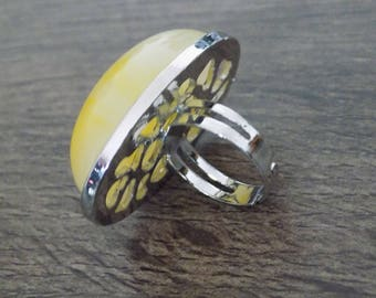 Yellow domed ring
