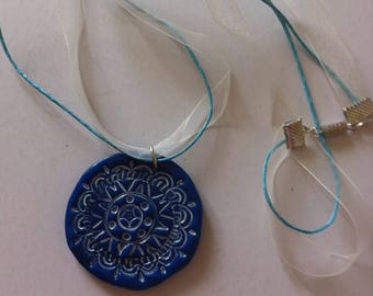 Necklace blue and white rose in fimo relief