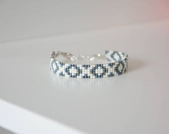 Black oil and creamy white woven bracelet