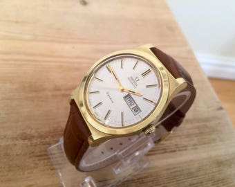 Omega vintage gold Geneve day date cal 1020 watch automatic movement white dial