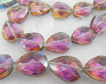 A set of 6 glass Teardrop beads faceted green and purple AB.