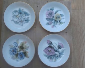 Four pin dishes by Royal Worcester