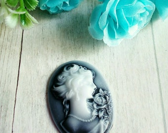 1 oval cameo portrait of woman in black resin