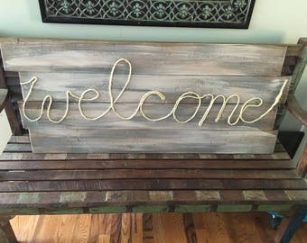 Welcome wooden rope sign