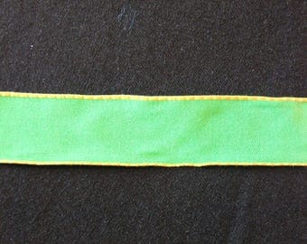 Green cotton trimmed with yellow ribbon