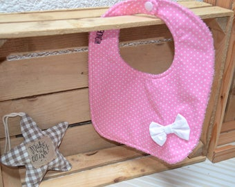 Pink bib with white polka dots and bow