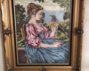 Framed Needlepoint picture of girl with bird