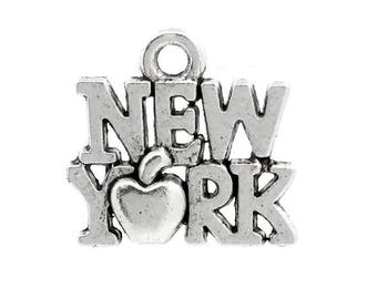 """x 2 """"NEW YORK"""" charms in silver."""