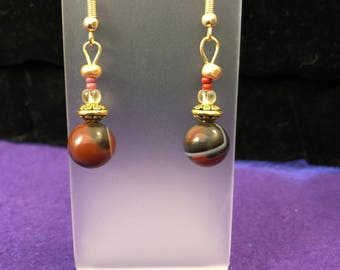 Gold toned and brown drop earrings.