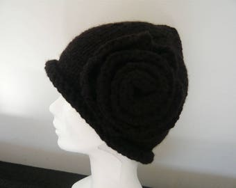 Knitted by hand with its flower