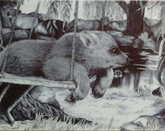 Bear cub on swing