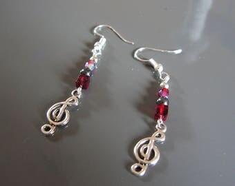Ruby red glass bead, grey, treble clef earrings