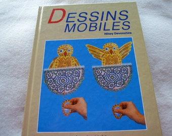 book designs mobile to decorate and amuse children