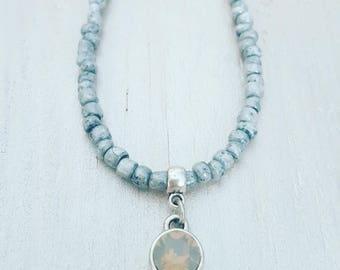 twentyonehappinezz • glasbead necklace with swarovski charm.