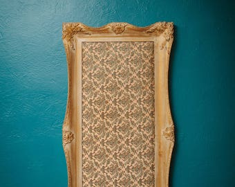 Antique frame with fabric cushion in center