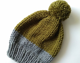 Wool kid hat with pompom. Cozy handmade beanie for child.