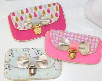 purse with gold leather bow