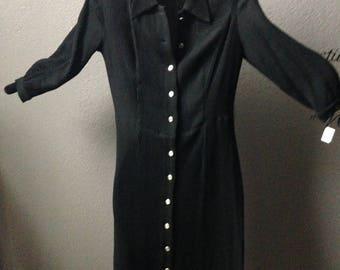 Black stretch knit dress with silver buttons