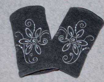 "Cufflinks ""scrolls of silver. Gray thread on fleece."