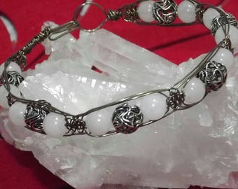 Wire wrapped bracelet made with frosted quartz and metal beads.