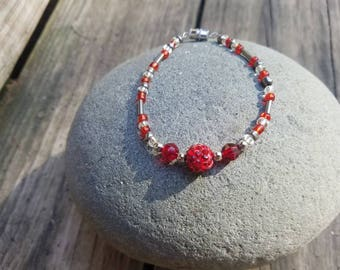 Red rhinestones and glass beads