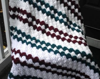 Hand crocheted burgundy/green afghan