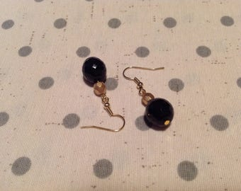 Earrings with black and gold faceted beads