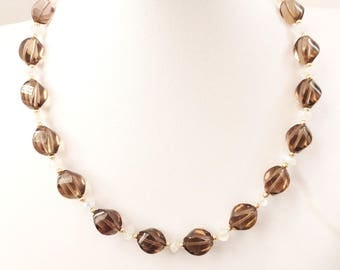 Gorgeous Smoky Quartz necklace. Large Smoky Quartz  oval twisted beads with Moonstone button, and Gold-filled small beads.