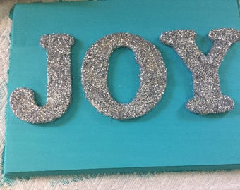 Glittered silver JOY on painted solid wood