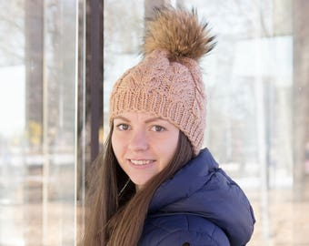 Women's woolen hat knitted with a natural fur pompon