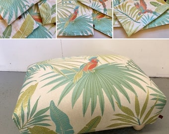 Foot stool upholstered in teal parrots tapestry