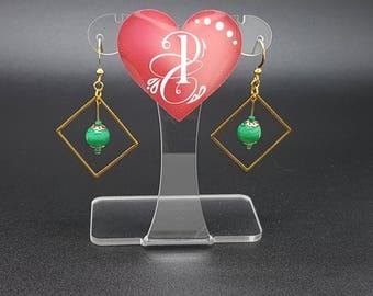 Earrings with green Murano glass bead.