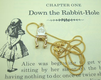 Alice in Wonderland Necklace - petite chair charm on a gold coloured snake chain