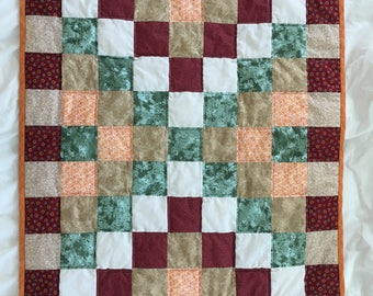 Neutral colored baby crib quilt