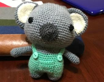 hand-made crochet koala with overalls