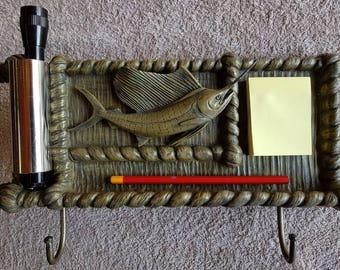 Sailfish keyholder/flashlight/notepad holder