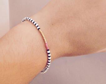 Black and white beaded bracelet with tassel