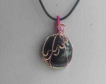 black cabachon stone with pink wire
