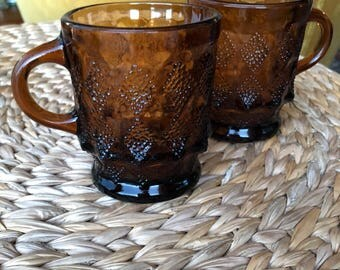 Pair of Vintage Fire King for Anchor Hocking Amber Kimberly Dot Mugs