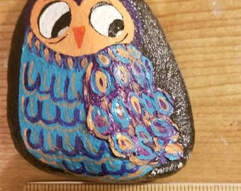 Painted Owl on river rock