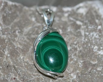 Malachite Pendant. Charming piece of Malachite in a nicely curved classic sterling silver lining. Handmade & unique.