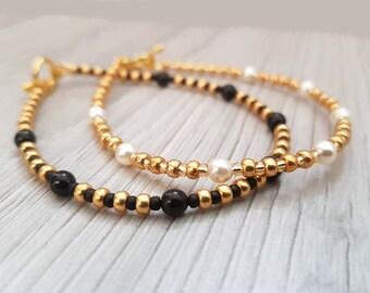 Dunne armbanden set | goud/wit en goud/zwart stapelbare armbanden | relatie armbanden | paar armbanden | lange afstand armbanden