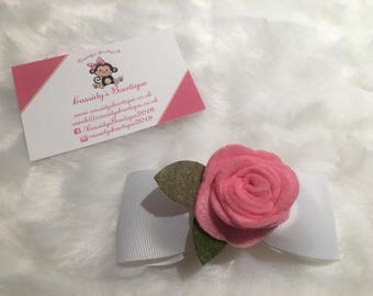 4inch White Bow With a Pink Rose